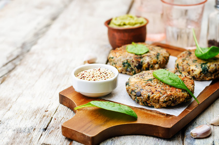 fritter: vegan quinoa eggplant spinach chickpeas Burger. Stock Photo