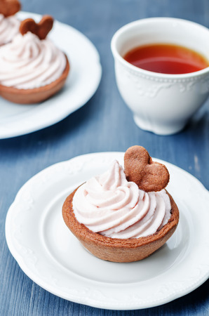 cream cheese: chocolate tartlets with berry cream cheese frosting.