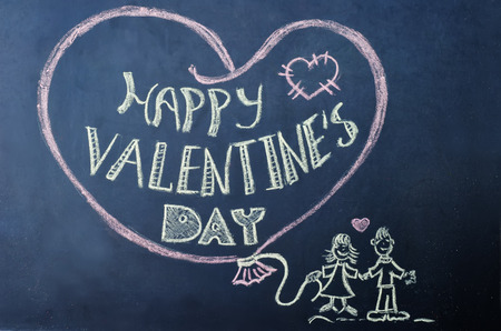 happy Valentines day written on the chalk Board. toning. selective focus