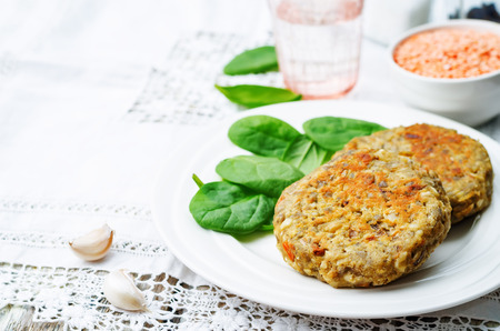 healthy lunch: red lentil seeds cashew carrot burgers on white background. toning. selective Focus