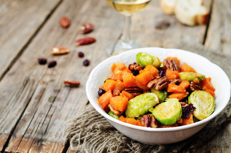 brussels sprouts: roasted brussels sprouts honey pumpkin pecan salad. toning. selective Focus Stock Photo