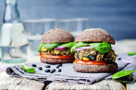 lunch meal: quinoa black bean spinach corn burgers with black beans bun crust. toning. selective Focus Stock Photo
