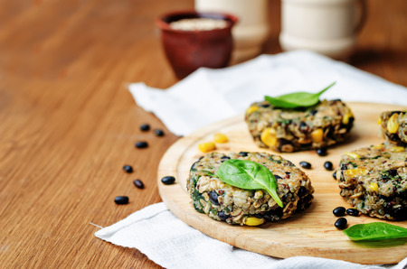 black bean: quinoa black bean spinach corn burgers on a brown background. toning. selective Focus Stock Photo