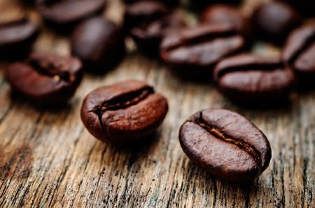 coffee beans on a dark wood backgound. toning. selective Focus