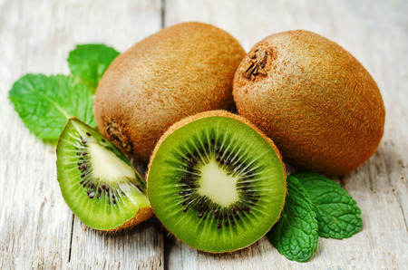 kiwi on a white wood background. toning. selective Focus