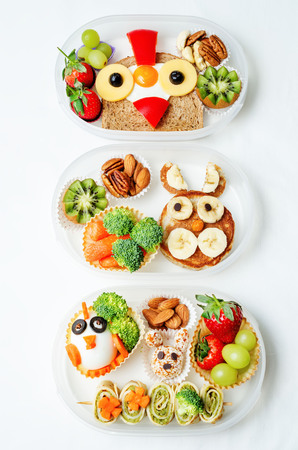 school form: school lunch box for kids with food in the form of funny faces. the toning. selective focus