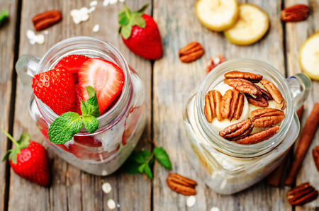overnight: homemade healthy Chia seeds banana pecan and strawberry overnight oatmeal in jars. toning. selective Focus