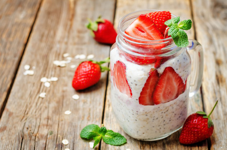 overnight: homemade healthy Chia seeds and strawberry overnight oatmeal in jar. toning. selective Focus