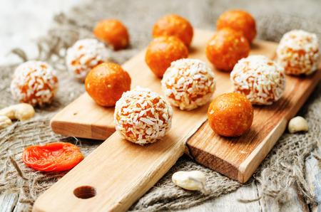 raw vegan cashew dried apricots, coconut balls. toning. selective focus