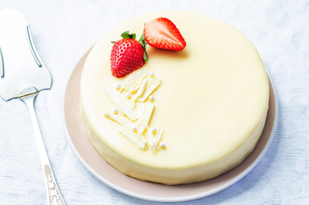 calorie rich food: white chocolate cream cheese cake with strawberries. toning. selective focus
