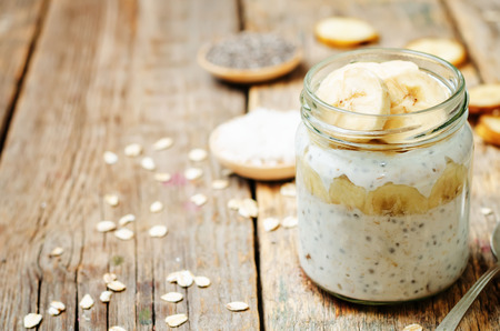 overnight: overnight oats with Greek yogurt, Chia seeds and banana. toning. selective focus Stock Photo
