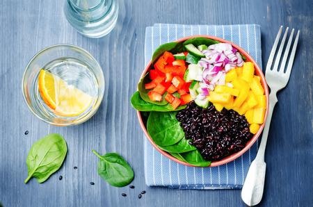 spinach, mango, black rice, pepper salad. toning. selective focus