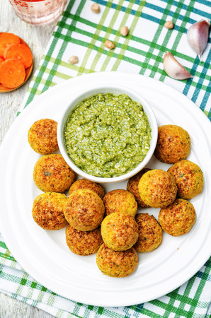 cooked pepper ball: pesto sauce with chickpeas carrots cilantro bites. toning. selective focus