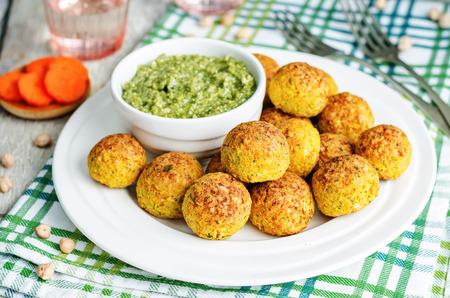 cooked pepper ball: chickpeas carrots cilantro bites with pesto sauce. toning. selective focus