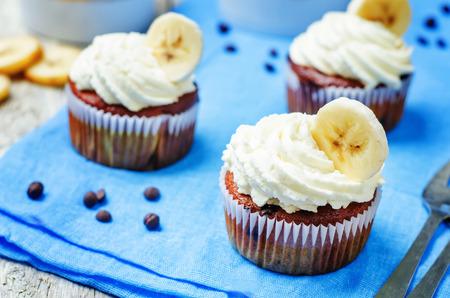 chocolate chips: chocolate chips banana cupcakes. toning. selective focus