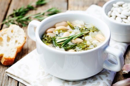 white bean: Rosemary white bean spinach soup. toning. selective focus Stock Photo