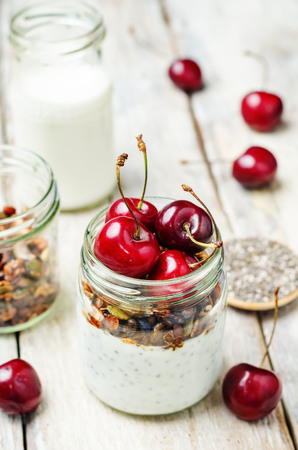 Chia seeds granola Greek yoghurt pudding with cherries. toning. selective focus