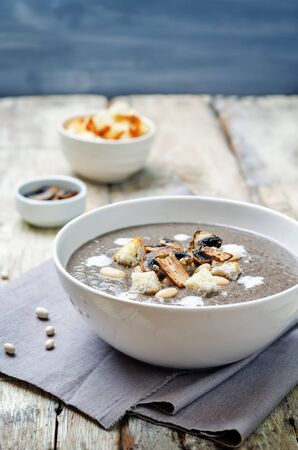 white bean: White bean mushrooms soup with croutons. toning. selective focus Stock Photo