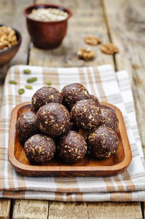 free dish: Dates cocoa coconut oats walnuts raw vegan balls. toning. selective focus