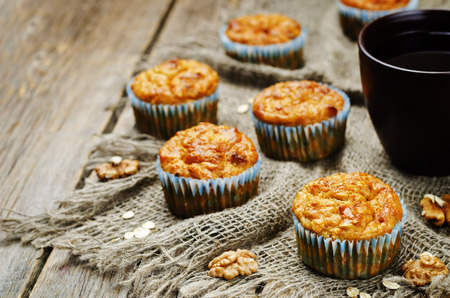 healthy walnuts dried apricots carrot oats muffins. toning. selective focus