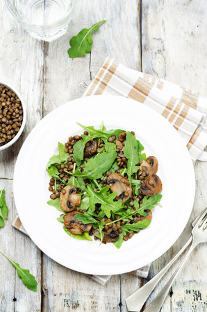 Green lentils mushroom arugula salad. toning. selective focus