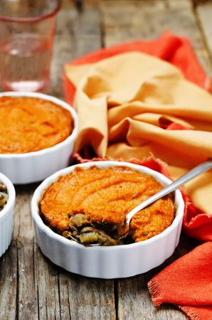 vegan green lentil mushroom sweet potato Shepherds pie. toning. selective focus