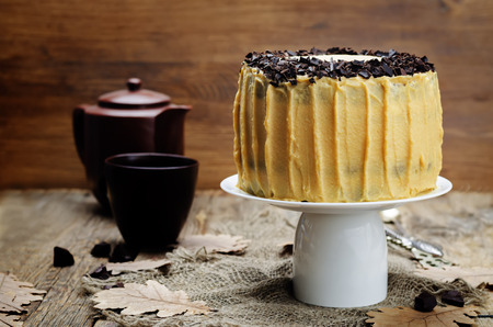 decorate: Pumpkin and chocolate layer cake with salted caramel cream cheese frosting. toning. selective focus