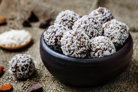 raw vegan almond butter coconut chocolate balls. toning. selective focus