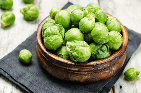 Brussels sprouts in a wooden bowl. toning. selective focus Stock Photo
