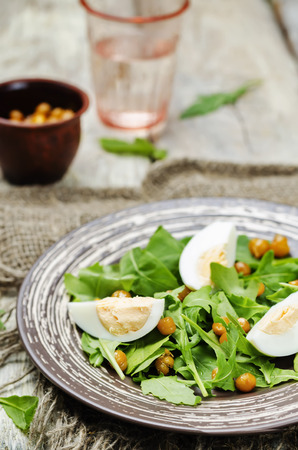 garbanzos: Roasted chickpeas eggs arugula salad. toning. selective focus