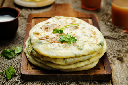 Indian Potato stuffed Flatbread. Aloo Paratha. toning. selective focus