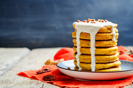 Carrot pancakes with sweet Greek yogurt sauce and pecan sprinkling. toning. selective focus Stock Photo - 67705744