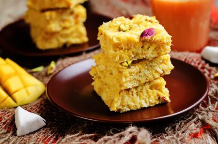 Mango Coconut Burfi. Indian sweets. toning. selective focus Фото со стока