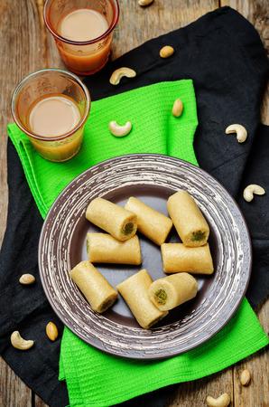 pista: Cashew Pistachio roll. Kaju pista roll. Indian sweets. toning. selective focus