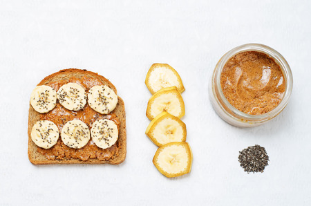 Healthy almond butter Chia seed banana rye breakfast sandwich. toning. selective focus Stock Photo
