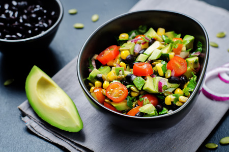 Black beans corn avocado red onion tomato salad with lime dressing. toning. selective focus Reklamní fotografie