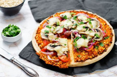 Sweet potato pizza crust with tomato, red onion and mushrooms. toning. selective focus Stock fotó