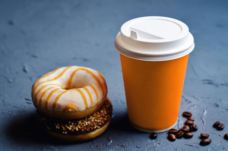 Donuts with coffee on a dark stone background. toning. selective focus  Reklamní fotografie