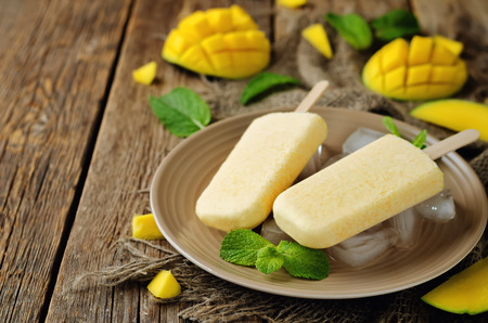 Creamy mango ice cream with fruits and ices. toning. selective focus Stock Photo