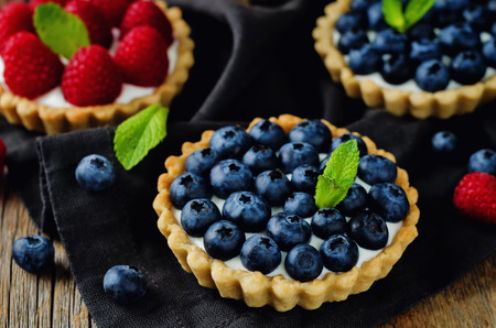 Raspberry and blueberry tartlets. toning. selective focus