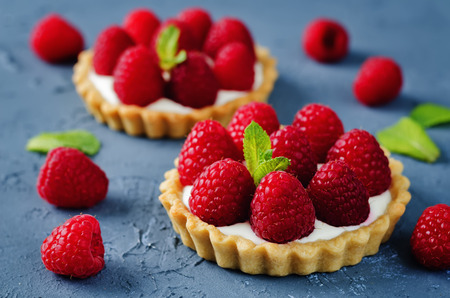 Raspberry tartlets. toning. selective focus