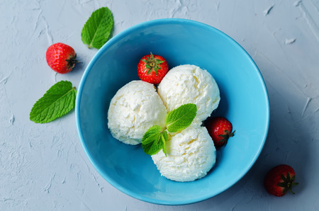 Vanilla Ricotta ice cream with strawberry and mint. toning. selective focus Stock Photo