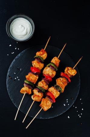 Chicken kebabs with vegetables and greek yogurt sauce. toning. selective focus