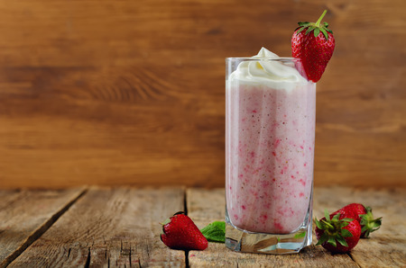 Strawberry milkshake with cream, fresh strawberries and mint. toning. selective Focus