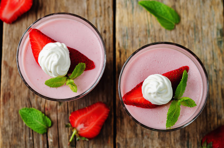 Strawberry panna cotta on a wood background. toning. selective focus Stock Photo