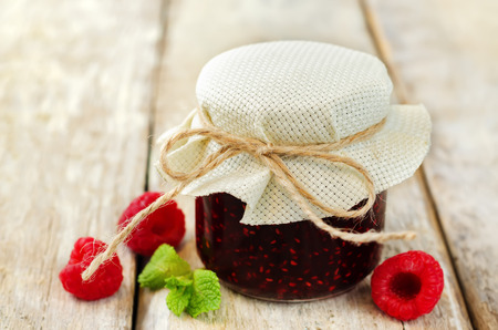 Raspberry jam with mint and fresh raspberries. toning. selective focus