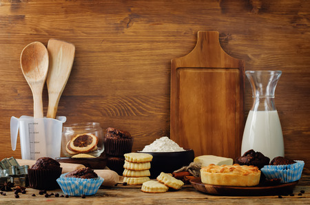 Baking ingredients and baking tools on a wood background. toning. selective focus
