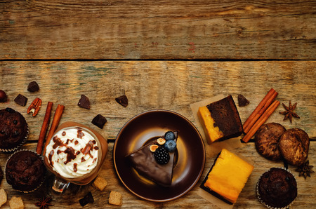 List of chocolate dishes. Cheesecake, muffins, cookies, pumpkin brownies, hot chocolate. toning. selective focus Stock Photo