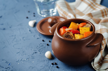 Pumpkin beef stew on a stone background. toning. selective focus Stock Photo