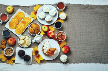 feast: Autumn sweets and baking celebration table setting. toning. selective focus